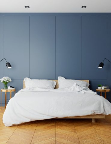 Vintage Modern  interior of  bed room, wood  bed  with wall lamp on  parguet flooring and dark blue  wall  ,3d rendering